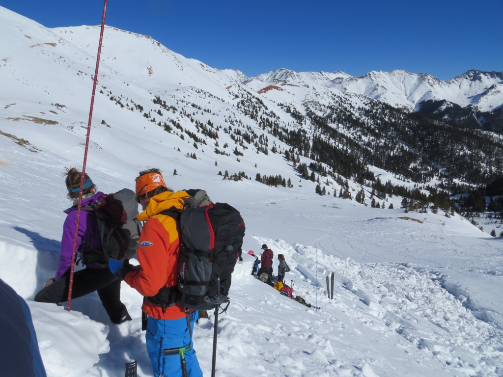 """AMGA Certified Ski and Rock Guide Chris """"Snowmarshall"""" Marshall assessing an R2D2 slide in Porspect Gulch.  San Juan Mountains, CO."""
