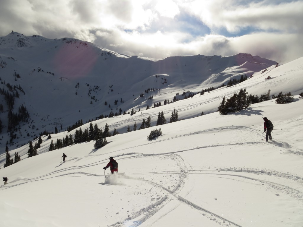 a group of friends skiing fresh San Juan powder near Red Mountain Pass and Silverton, CO