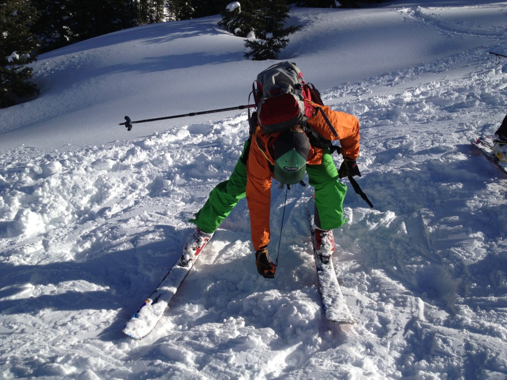 American Mountain Guides Association (AMGA) Aprentice Ski Guide Mike Henderson using his Backcountry Access Tracker 2 to find the prize and on American Institue for Avalanche research and Education Level 2 avalanche course on Red Mountain Pass.  San Juan Mountains,  CO