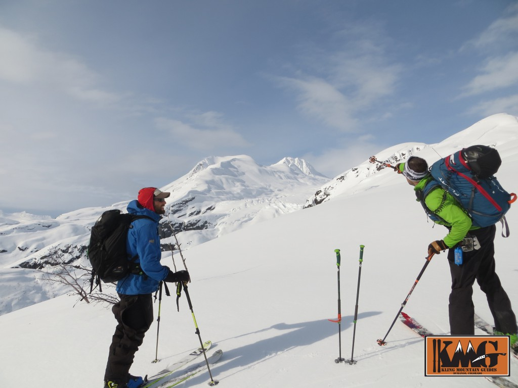 AMGA Certified Alpine and Rock guide Josh Kling discussing terrain options with Britt on Thompson Pass outside of Valdez, AK.