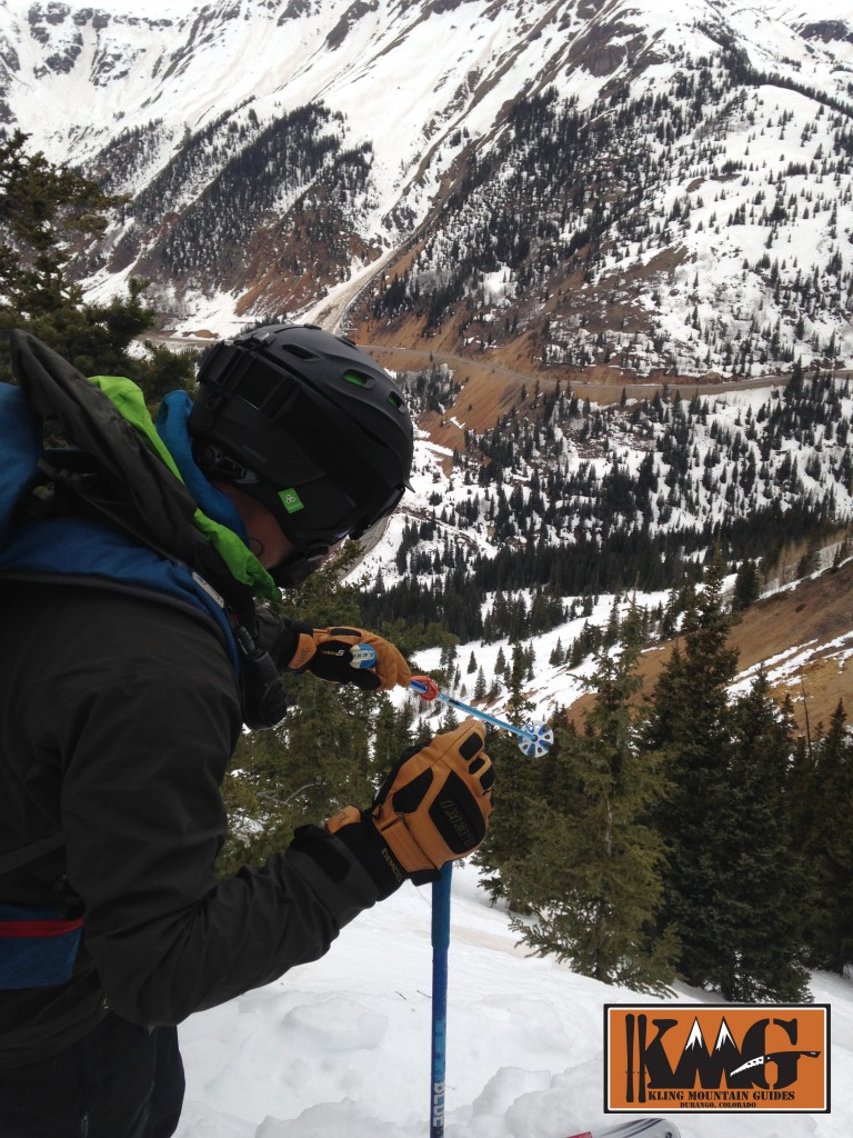 AIARE Level 2 course leader and IFMGA Aspirant Mountain Guide Josh Kling discussing terrain options on Red Mountain Pass with an AIARE Level 2 avalanche course.